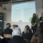 Launch event at Switchboard Studios, showing groups of people listening to a presentation