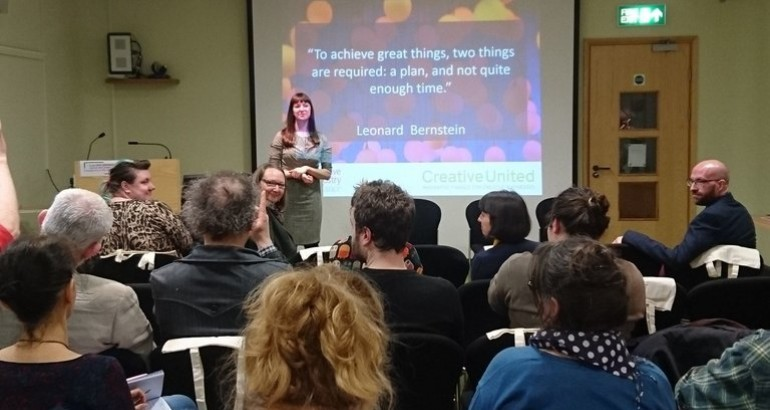 Image of woman giving a presentation