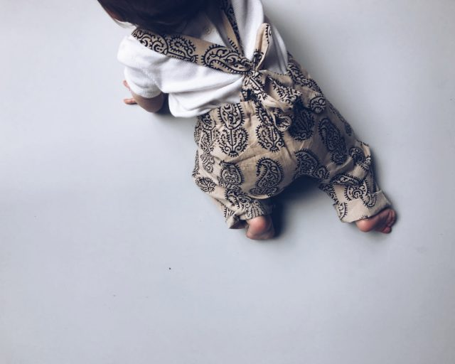 Photo of baby wearing printed suit