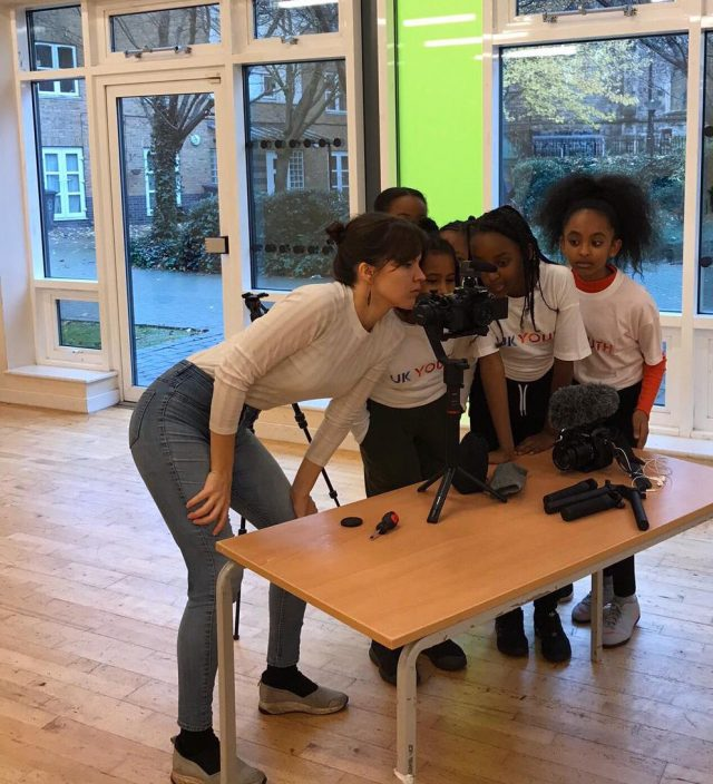 Showing students learning how to use a video camera