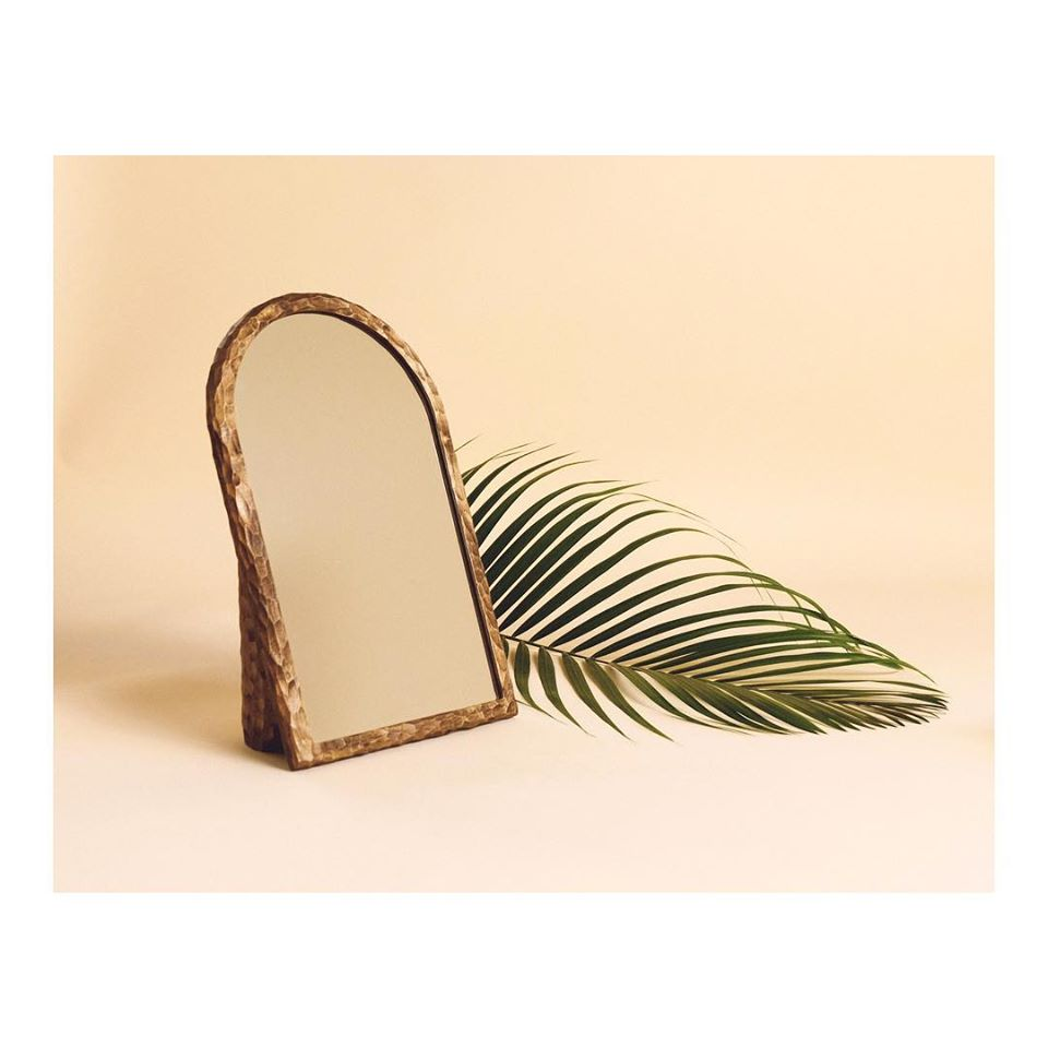 Product shot showing mirror and fern