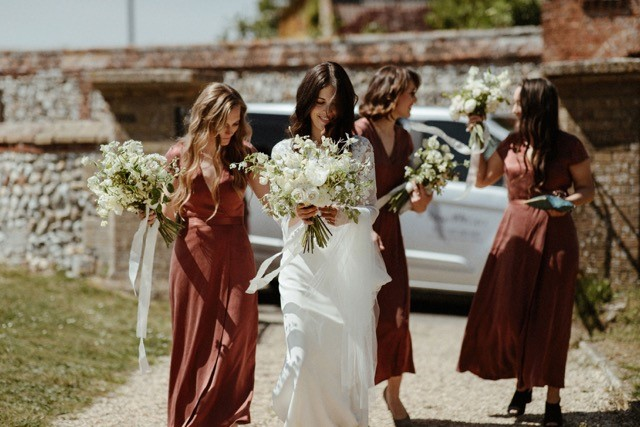 Wedding photo, showing a bride carrying photos