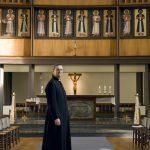 Image of a vicar inside a church