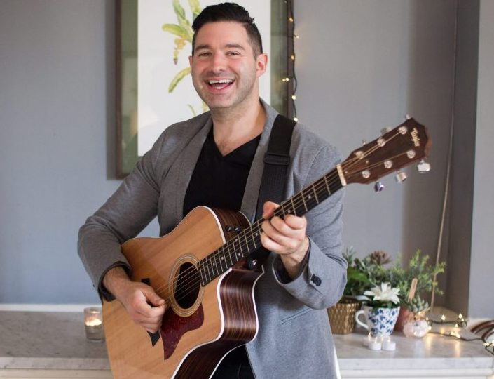 photo of man playing the guitar