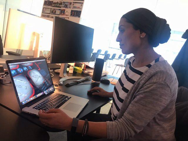 Roz sitting at her desk working on designs
